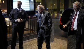 Former House Speaker Dennis Hastert, center, arrives at the federal courthouse Wednesday, Oct. 28, 2015, in Chicago.. (AP Photo/Matt Marton )
