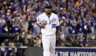 Kansas City Royals pitcher Edinson Volquez reacts after getting New York Mets' David Wright out to end the third inning of Game 1 of the Major League Baseball World Series Tuesday, Oct. 27, 2015, in Kansas City, Mo. (AP Photo/David J. Phillip)