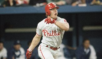 Philadelphia Phillies Lenny Dykstra watches his three-run homer fly during the seventh inning of Game 6 in the World Series against the Toronto Blue Jays Saturday, Oct. 23, 1993 at Sky Dome in Toronto. (AP Photo/John Swart)