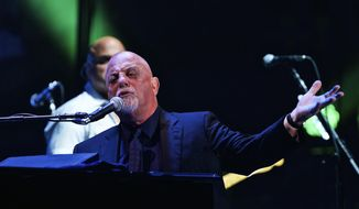 "In this Wednesday, July 1, 2015, photo, Billy Joel performs for a record 65th time at Madison Square Garden in New York. A spokesman for Joel tells Newsday that the ""Piano Man"" will lead Citi Field in the national anthem prior to Game 3 of the World Series baseball game, on Friday, Oct. 30, between the New York Mets and the Kansas City Royals. (Photo by Robert Altman/Invision/AP, File)"