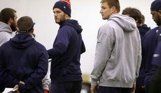 New England Patriots quarterback Tom Brady, center left, and tight end Rob Gronkowski, center right, participate in an NFL football practice, Tuesday, Oct. 27, 2015, in Foxborough, Mass. The Miami Dolphins are to play the Patriots Thursday, Oct. 29, in Foxborough. (AP Photo/Steven Senne)