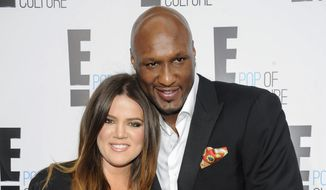 "In this April 30, 2012, file photo, Khloe Kardashian Odom and Lamar Odom from the show ""Keeping Up With The Kardashians,"" attend an E! Network upfront event at Gotham Hall in New York. (AP Photo/Evan Agostini, File)"
