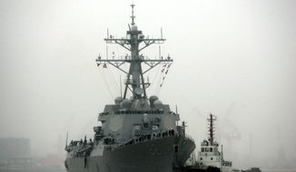 In this April 8, 2008, file photo, guided missile destroyer USS Lassen arrives at the Shanghai International Passenger Quay in Shanghai, China, for a scheduled port visit. The USS Lassen has sailed past one of China's artificial islands in the South China Sea on Tuesday, Oct. 27, 2015, in a challenge to Chinese sovereignty claims that drew an angry protest from Beijing, which said the move damaged US-China relations and regional peace. (AP Photo/Eugene Hoshiko, File)