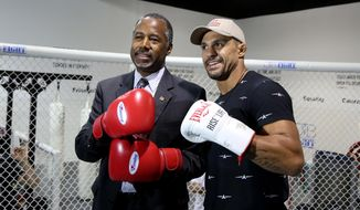 UFC middleweight fighter Vitor Belfort poses with presidential candidate Ben Carson at the OTB Fight gym in Coconut Creek, Fla. Belfort is endorsing Carson.  (Susan Stocker/South Florida Sun-Sentinel via AP)  MAGS OUT; MANDATORY CREDIT
