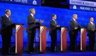 Jeb Bush, second from left, is flanked by Mike Huckabee, left, Marco Rubio, center, Donald Trump, second from right, and Ben Carson during the CNBC Republican presidential debate at the University of Colorado, Wednesday, Oct. 28, 2015, in Boulder, Colo. (AP Photo/Mark J. Terrill)