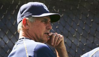 San Diego Padres manager Bud Black relaxes leaning on the batting cage while watching pitchers hit prior to a baseball game against the Houston Astros Monday, April 27, 2015 in San Diego. (AP Photo/Lenny Ignelzi))