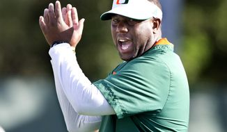 Miami interim head coach Larry Scott leads an NCAA college football practice Tuesday, Oct. 27, 2015, in Coral Gables, Fla. Miami fired coach Al Golden on Sunday. (Al Diaz/The Miami Herald via AP)  MAGS OUT; MANDATORY CREDIT