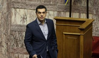 Greek Prime Minister Alexis Tsipras arrives for a parliament meeting about the government's migrant policy in Athens, Friday, Oct. 30, 2015. (AP Photo/Thanassis Stavrakis)