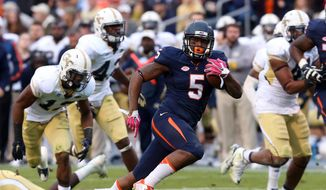 Virginia quarterback David Watford (5) runs between Georgia Tech defenders for a touchdown during the second half of an ACC college football at Scott Stadium, Saturday, Oct. 31, 2015, in Charlottesville, Va. (AP Photo/Andrew Shurtleff)