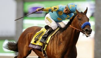 American Pharoah, with Victor Espinoza up, wins the Breeders' Cup Classic horse race at Keeneland race track Saturday, Oct. 31, 2015, in Lexington, Ky. (AP Photo/Mark Humphrey)