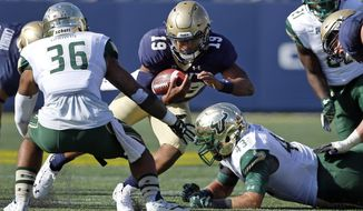 Navy quarterback Keenan Reynolds (19) rushes the ball against South Florida defensive back Nate Godwin, left, and linebacker Auggie Sanchez, bottom right, in the second half of an NCAA college football game, Saturday, Oct. 31, 2015, in Annapolis, Md. (AP Photo/Patrick Semansky)