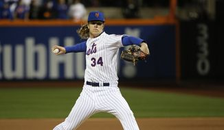 New York Mets pitcher Noah Syndergaard winds up to throw during the first inning of Game 3 of the Major League Baseball World Series against the Kansas City Royals Friday, Oct. 30, 2015, in New York. (AP Photo/Matt Slocum)