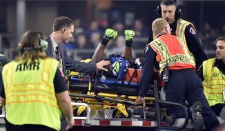 Seattle Seahawks' Ricardo Lockette signals to cheering fans as he is carted off the field in the first half of an NFL football game against the Dallas Cowboys, Sunday, Nov. 1, 2015, in Arlington, Texas. (AP Photo/Michael Ainsworth)