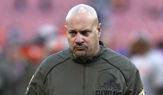Cleveland Browns head coach Mike Pettine walks off the field after the Cardinals defeated the Browns 34-20 in an NFL football game Sunday, Nov. 1, 2015, in Cleveland. (AP Photo/Ron Schwane)