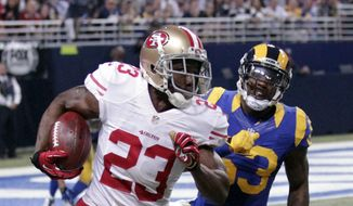 San Francisco 49ers running back Reggie Bush (23) runs with the ball as St. Louis Rams linebacker Daren Bates pursues during the first quarter of an NFL football game Sunday, Nov. 1, 2015, in St. Louis. (AP Photo/Tom Gannam) **FILE**