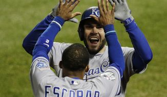 Kansas City Royals' Eric Hosmer celebrates with Alcides Escobar (2) after scoring on an RBI single during the eighth inning of Game 4 of the Major League Baseball World Series against the New York Mets Saturday, Oct. 31, 2015, in New York. (AP Photo/Julie Jacobson)
