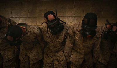 Recruits of Charlie Company, 1st Recruit Training Battalion, shake their heads during chemical warfare defense training June 3, 2014, on Marine Corps Recruit Depot Parris Island, S.C. The recruits shook their heads and performed other exercises to prove their gas masks worked despite vigorous activity.  (U.S. Marine Coprs photo by Cpl. Octavia Davis/Released)