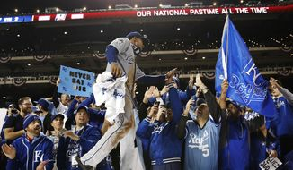 Kansas City Royals' Jarrod Dyson celebrates with fans after Game 5 of the Major League Baseball World Series against the New York Mets Monday, Nov. 2, 2015, in New York. The Royals won 7-2 to win the series. (AP Photo/Matt Slocum)