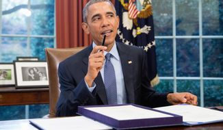 """President Barack Obama speaks to members of the media after signing H.R. 1314, the """"Bipartisan Budget Act of 2015,"""" Monday, Nov. 2, 2015, in the Oval Office in the White House in Washington, before traveling Andrews Air Force Base, Md., on his way to Newark, N.J. Obama will spend the day highlighting the re-entry process of formerly incarcerated individuals back into society. (AP Photo/Andrew Harnik)"""