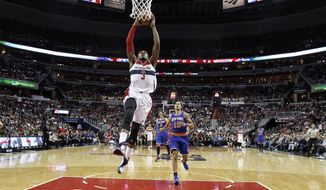 Washington Wizards guard Bradley Beal (3) goes up for the dunk in the first half of an NBA basketball game against the New York Knicks, Saturday, Oct. 31, 2015, in Washington. (AP Photo/Alex Brandon)