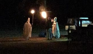 Lahoma, Oklahoma, Mayor Theresa Sharp has apologized after a photo surfaced on social media showing her husband, Cary Sharp, participating in a fake KKK rally. (The Enid News & Eagle)