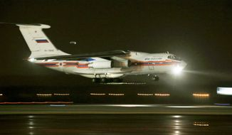 Russian Ministry for Emergency Situations cargo plane carries the bodies of the victims lands at Pulkovo airport outside St. Petersburg, Russia, Monday, Nov. 2, 2015. Metrojet's Airbus A321-200 crashed in the Sinai Peninsula on Saturday morning 23 minutes after taking off from Sharm el-Sheikh en route to St. Petersburg. All 224 people on board were killed, the vast majority of them Russians. (AP Photo/Dmitry Lovetsky, Pool)
