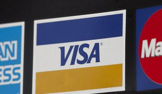 In this March 19, 2012, file photo, a sign for Visa is shown in New York. Visa plans to buy Visa Europe in a cash-and-stock deal that could be worth more than $23 billion. (AP Photo/Mark Lennihan, File)