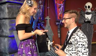 Washington, D.C., film critic Kevin McCarthy (right) surprised girlfriend Lauren Veneziani with a Halloween proposal at Disney World in Florida.  (Facebook)