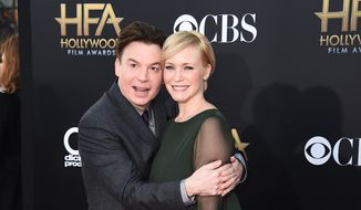 Mike Myers, left, and Kelly Tisdale arrive at the Hollywood Film Awards at the Palladium in Los Angeles, in this Nov. 14, 2014, file photo. A spokeswoman for Myers said that Kelly gave birth Monday, Nov. 2, 2015, to their daughter Paulina Kathleen in New York City. (Photo by Jordan Strauss/Invision/AP, FIle)