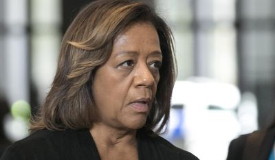 FILE - In this Oct. 13, 2015, file photo, former Chicago Public Schools CEO Barbara Byrd-Bennett speaks before leaving federal court in Chicago, after she pleaded guilty to helping steer $23 million in no-bid contracts to education firms for $2.3 million in kickbacks and bribes while at Chicago. Court documents, obtained Monday, Nov. 2, 2015, by the Chicago Sun-Times, show the FBI was investigating whether  Byrd-Bennett fraudulently steered a $40 million contract to an educational publisher while she worked for Detroit schools prior to accepting the position she held in Chicago. (Ashlee Rezin/Sun-Times Media via AP, File)