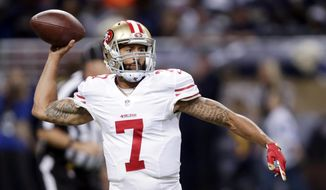 FILE - In this Nov. 1, 2015, file photo, San Francisco 49ers quarterback Colin Kaepernick throws during the first quarter of an NFL football game against the St. Louis Rams in St. Louis. A person with knowledge of the decision said quarterback Kaepernick has been told he won't start Sunday, Nov. 8, 2015, for the 49ers, replaced by backup Blaine Gabbert. The person spoke on condition of anonymity Monday, Nov. 2, 2015, because the decision wasn't to be discussed publicly. (AP Photo/Tom Gannam, File)