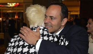 Kentucky Republican gubernatorial candidate Matt Bevin hugs a supporter at the Republican Party celebration Tuesday Louisville, Ky. Mr. Bevin defeated Democrat Jack Conway to become only the second Republican governor in the state in four decades. (Associated Press)