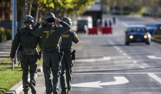 Merced County Sheriff SWAT members enter the University of California, Merced campus after a reported stabbing in Merced, Calif., Wednesday, Nov. 4, 2015. An assailant stabbed five people on the rural university campus in central California before police shot and killed him, authorities said Wednesday.  (Andrew Kuhn/Merced Sun-Star via AP)