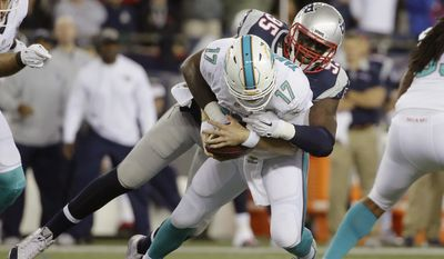 New England Patriots defensive end Chandler Jones (95) sacks Miami Dolphins quarterback Ryan Tannehill (17) in the first half an NFL football game, Thursday, Oct. 29, 2015, in Foxborough, Mass. (AP Photo/Steven Senne)