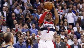 Washington Wizards guard Bradley Beal (3) goes up for the game-winning shot with coach Randy Wittman behind him, during the second half of an NBA basketball game against the San Antonio Spurs, Wednesday, Nov. 4, 2015, in Washington. The Wizards won 102-99. (AP Photo/Alex Brandon)