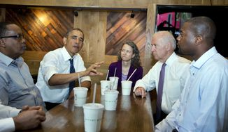 President Obama, accompanied by Vice President Joe Biden, meets with (from left) Abdullahi Mohamed, Meredith Upchurch and Antonio Byrd at the Shake Shack in Washington on May 16, 2014. Obama seems to have caught a bad case of cabin fever. Since taking office, Obama has periodically grumbled about the claustrophobia that sets in when his every move is surrounded by intense security, rendering it nearly impossible to enjoy the simple pleasures that private citizens take for granted. But in recent days, the president has made more of a point to get out.  (Associated Press) **FILE**