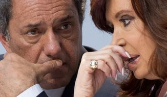 Voters in Argentina defied the polls last month and refused to rubber-stamp longtime leftist President Cristina Fernandez's handpicked candidate, instead forcing Daniel Scioli into a runoff. (Associated Press)