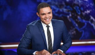 """In this Sept. 29, 2015, file photo, Trevor Noah appears on set during a taping of """"The Daily Show with Trevor Noah"""" in New York. (Photo by Evan Agostini/Invision/AP, File)"""