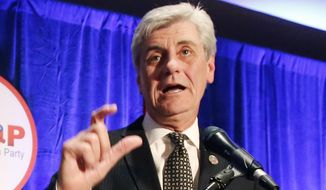Republican Gov. Phil Bryant speaks to friends and supporters during an election night party, Tuesday, Nov. 3, 2015, in Jackson, Miss. (AP Photo/Rogelio V. Solis) ** FILE **