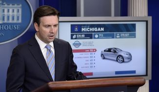 White House press secretary Josh Earnest uses a graphic to discuss the Trans-Pacific Partnership (TPP) during the daily briefing at the White House in Washington, in this Oct. 13, 2015, file photo. Officials released details of a sweeping Pacific Rim trade deal Thursday, Nov. 5, 2015. (AP Photo/Susan Walsh, File)