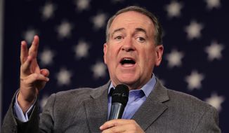 Republican presidential candidate Mike Huckabee, speaks at the Iowa GOP's Growth and Opportunity Party at the Iowa state fair grounds in Des Moines, Iowa, on Oct. 31, 2015. (Associated Press) **FILE**
