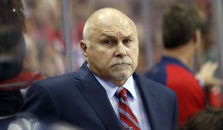 Washington Capitals head coach Barry Trotz stands behind the bench during the first period of an NHL hockey game against the New Jersey Devils, Saturday, Oct. 10, 2015, in Washington. (AP Photo/Alex Brandon)