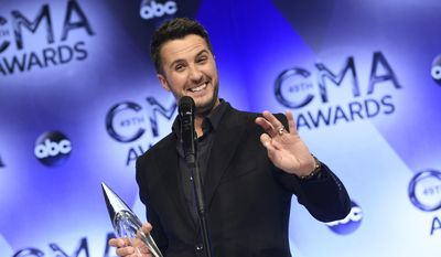 Luke Bryan, winner of the award for entertainer of the year, poses in the press room at the 49th annual CMA Awards at the Bridgestone Arena on Wednesday, Nov. 4, 2015, in Nashville, Tenn. (Photo by Evan Agostini/Invision/AP)