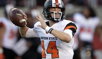 FILE - In this Oct. 31, 2015, file photo, Oregon State quarterback Nick Mitchell prepares to pass the ball against Utah in the first quarter during an NCAA college football game, in Salt Lake City. Mitchell's first tests at starting quarterback for Oregon State have been challenging, to say the least. (AP Photo/Rick Bowmer, File)