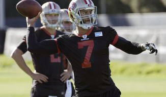 San Francisco 49ers quarterback Blaine Gabbert, rear, watches as quarterback Colin Kaepernick (7) passes during an NFL football practice in Santa Clara, Calif., Wednesday, Nov. 4, 2015. Head coach Jim Tomsula announced that the 49ers have officially made the change at quarterback from Kaepernick to Gabbert. (AP Photo/Jeff Chiu)