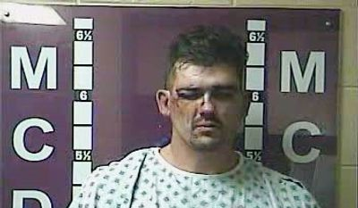 This booking photo released by the Madison County Detention Center shows Raleigh Sizemore, 34, who is charged with attempted murder for allegedly shooting at a Kentucky police officer who was searching a Richmond, Ky., apartment complex for a robbery suspect on Wednesday, Nov. 4, 2015. A second officer returned fire and struck Sizemore. He was treated at the hospital and released to police custody. (Madison County Detention Center via AP)