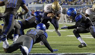 Navy quarterback Keenan Reynolds (19) is stopped at the two-yard line by Memphis defenders Shareef White (30), Wynton McManis (16) and defensive back DaShaughn Terry, right, in the first half of an NCAA college football game Saturday, Nov. 7, 2015, in Memphis, Tenn. (AP Photo/Mark Humphrey)