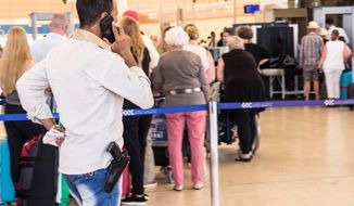 An armed security worker talks on his phone in front of the luggage screening section at the airport of Sharm el-Sheikh, Egypt, Saturday, Nov. 7, 2015.  In an abrupt turnaround, Russia on Friday suspended all passenger flights to Egypt after days of resisting U.S. and British suggestions that a bomb may have brought down a Russian plane in the Sinai Peninsula a week ago. (AP Photo/Vinciane Jacquet)