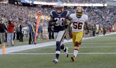New England Patriots running back Brandon Bolden (38) scores a touchdown in front of Washington Redskins linebacker Perry Riley (56) during the second half of an NFL football game, Sunday, Nov. 8, 2015, in Foxborough, Mass. (AP Photo/Steven Senne)