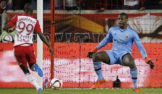 New York Red Bulls forward Bradley Wright-Phillips (99) prepares to score a goal against D.C. United goalkeeper Bill Hamid during the second half of an MLS playoff soccer match, Sunday, Nov. 8, 2015, in Harrison, N.J. (AP Photo/Julio Cortez)